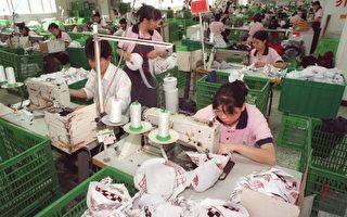 專家認爲中國企業内部結構比例失調,管理不足,勞工過剩(法新社)