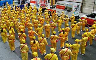 组图:法轮功学员参加纽约老兵节游行