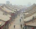 遥遥古城,贯今时情?(Photo by China Photos/Getty Images)