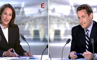 2007 年5月02 日,法国总统大选决选的两位候选人,贺雅尔(左)与沙柯吉(右)今天展开电视辩论,吸引法国全国民众关切,许多民众在各所在场合开起电视看即时转播。(THIERRY ZOCCOLAN/AFP/Getty Images)