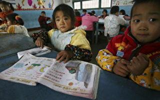 在中国每400 名学生有三分之一是从贫困家庭。(China Photos/Getty Images)