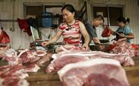北京一家豬肉鋪。7月2日,北京豬肉批發價格再創新高。(法新社)