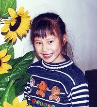 父亲被迫害致死,母亲被关监狱的小女孩:吕明慧(明慧网图片)