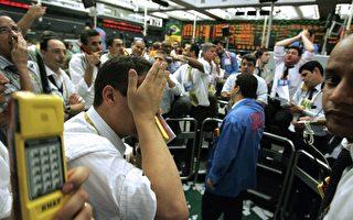 美国次级信贷危机阴影笼罩全球股市。(图:法新社)