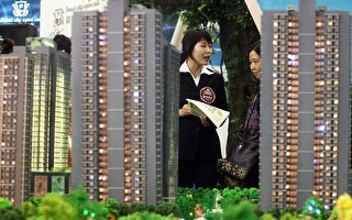 中国房地产市场面临着即将泡沫化的危机,也成为威胁社会稳定的潜在危险因数。(STR/AFP/Getty Images)