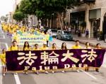10月15日,来自世界各地的部分法轮功学员参加洛杉矶大游行。(爱德华/大纪元)