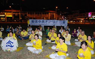 新加坡法輪功學員燭光悼念籲停止迫害
