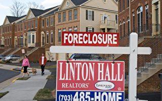 """2011年第一季,美国的房屋贷款中估计将有48%,约2,500万房主,积欠银行的贷款金额超过房屋价值,而处于所谓""""溺水""""状态。(PAUL J. RICHARDS/AFP/Getty Images)"""