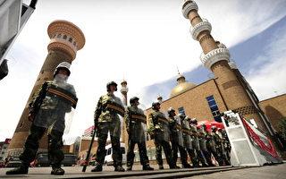 发生在今年七月五日新疆首府乌鲁木齐的镇暴事件震惊世界(PETER PARKS/AFP/Getty Images)
