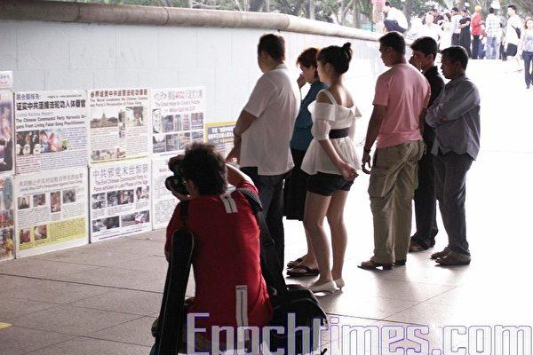 新加坡再次抓捕法輪功學員的若干疑點
