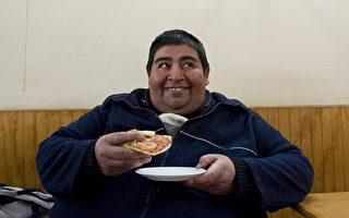尽管体重过重不会增加死亡率,但过胖却会增加大约20%的死亡率。(AFP/Getty Image)