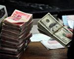 人民幣中間價已九連降 明年或破7