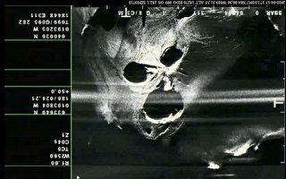 4月16日攝得的埃亞菲亞德拉3個火山口的雷達回波圖,乍看下如一張怒吼的鬼臉。(法新社)