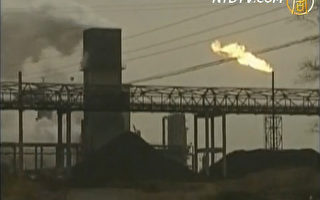 江苏省常州市政府对几千家工厂下达了轮流停电命令,让这些工厂每运营9天,就停工5天。浙江地区的工厂同样遇到断断续续的停电。( 电视截图 / 新唐人)
