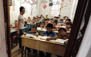 """""""在全球21个受调查国家中,中国孩子的计算能力排名第一,想像力排名倒数第一,创造力排名倒数第五。为什么会出现这样的现象?"""" (Photo credit should read STR/AFP/Getty Images)(Stringer: STR / 2010 AFP)"""