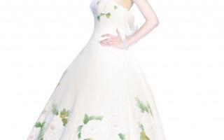 台灣名模蔡淑臻穿上近百萬的手繪牡丹白紗走秀,以日本特有技藝融合東、西方文化之美,吸引上戶彩、廣末涼子等日本女星選穿。 (圖片來源:LES FEES COUTURE提供)