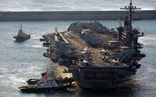 美國航空母艦卡爾文森號將於5月22日訪問香港,特區政府派出反恐特勤隊戒備。圖為2011年1月11日,卡爾文森號抵達韓國釜山南部港口。(圖片來源:PARK JI-HWAN/AFP)