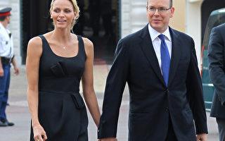 摩纳哥大公国亲王亚伯特二世(右)将于7月1与新娘夏琳.维斯托克(左)举行婚礼。(AFP PHOTO / VALERY HACHE)