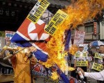 朝鲜核试爆后,韩国民众焚烧朝鲜国旗(Getty Images)