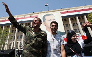 叙利亚当局1年多来血腥镇压反政府运动的军事行动4月12日有暂停的迹象,反对派未再提出新的伤亡,然而军队仍然未依协议彻出平民区,给和平协议的未来打下了问号。图为首都大马士革出现难得的平静。(LOUAI BESHARA/AFP)