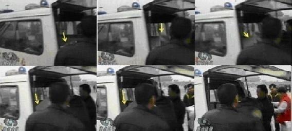 图12 非医务人员从救护车上扯下白色被单