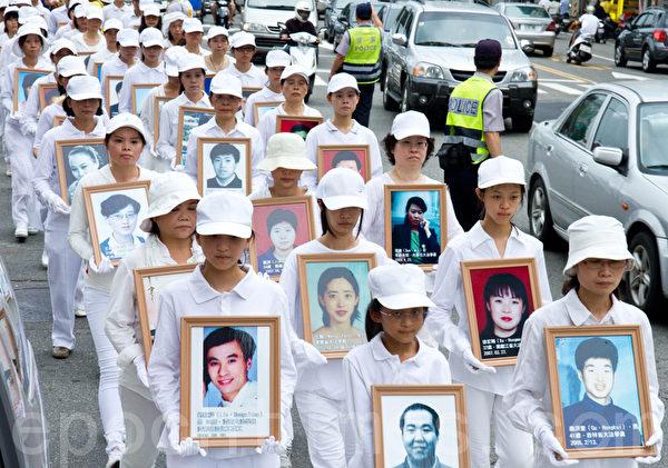 2012年7月21日,台湾法轮功学员于台中市举行720反迫害游行。(摄影:陈柏州 / 大纪元)