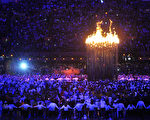 EDITORIAL USE ONLY  LONDON, ENGLAND - JULY 27:  Flames leap from the cauldron during the Opening Ceremony of the London 2012 Olympic Games at the Olympic Stadium on July 27, 2012 in London, England.  (Photo by John Stillwell  - WPA Pool /Getty Images)