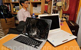 香港独立媒体8日下午办事处遭歹徒闯入用铁槌猛敲电脑破坏。(摄影:宋祥龙/大纪元)