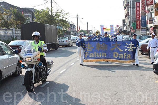 马来西亚退党服务中心希望通过多次的声援三退活动,能让更多国人了解真相。(摄影:滕飞/大纪元)