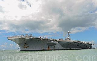 美國海軍第七艦隊宣佈,美國兩個航母戰鬥群目前正在西太平洋執行警戒任務。圖為航空母艦「喬治·華盛頓號」。資料照片。(攝影:孫青天/大紀元)