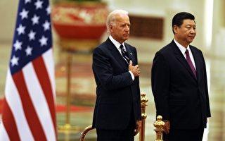 与习近平私交密切的美国副总统拜登日前表示,习近平接管棘手工作,工作有好的结果符合美国的利益。图为美国副总统拜登访华期间,同习近平在欢迎仪式上。(AFP)