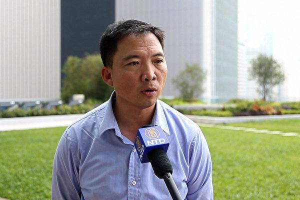 6月11日,香港民主黨在香港城市大學舉辦了「回歸20周年研討會」,並發表題為「回歸二十年一國兩制『不走樣、不變形』?」的報告。圖為香港民主黨主席胡志偉。(潘在殊/大紀元)