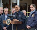 2012 年 11 月 15 日,美國總統奧巴馬到桑迪颶風受災嚴重的史泰登島訪問,並發表講話。(MANDEL NGAN / AFP)