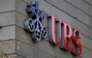 瑞士银行(UBS)因操控Libor(伦敦银行同业拆款利率),可能面临超过10亿美元的天价罚款。图为苏黎世市瑞士银行总部的瑞银徽标。(FABRICE COFFRINI/AFP)