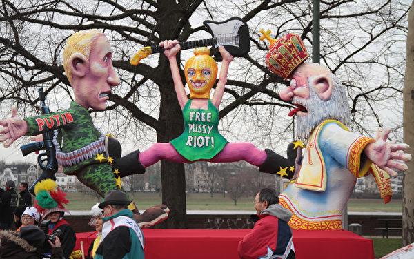 关于俄罗斯乐队三名女歌手抗议普京而被构陷的丑闻 (Juergen Schwarz/Getty Images)
