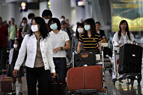 新型冠状病毒全球确定个案12宗,近日再多一人死亡,使死亡人数增至6人。香港市民对沙士重临的担忧,也与日俱增。图为香港机场档案照片。(AFP)