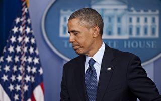 """美国联邦政府的强制减支已经于星期五晚正式启动,目前各方关注的焦点已经转移到3月底政府可能被迫关门上面。分析认为,接踵而至的系列财政""""悬崖""""可能耗竭国会的大部分精力,从而使奥巴马总统在移民改革、控制枪支方面的议题被迫推迟。(Saul LOEB/AFP)"""