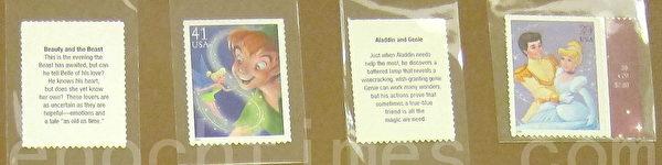 美国发行迪士尼卡通邮票,依次为美女与野兽(背面)、小飞侠与小叮玲(正面)、阿拉丁与神灯(背面)、灰姑娘与王子(正面)。(摄影:钟元/大纪元)