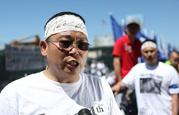 """公民力量主席杨建利表示,""""天安门大屠杀""""24年来,中共对法轮功学员、藏人、维族人、强拆维权者、黑监狱受害者等等的迫害都说明,""""六‧四""""的屠杀还在继续,人权侵害一直延续到今天。(摄影:杜国辉/大纪元)"""