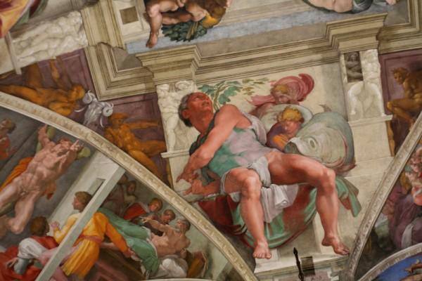 """米开朗基罗者以""""前缩法""""将约拿的身体画成向后出的姿态,正好和向前弯的壁面在视觉上互相抵消,不仅自然而且更为立体生动。约拿向后仰头,仿佛正在和神讨价还价。"""