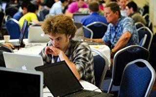 世界最開放且最強大的信息交流中心--美國研究型大學正遭受著每週數百萬次的網絡攻擊,其中大部份來自中國。圖為2012年7月10日,計算機黑客攻擊美國喬治.華盛頓大學的網絡。(AFP PHOTO/Jim Watson)