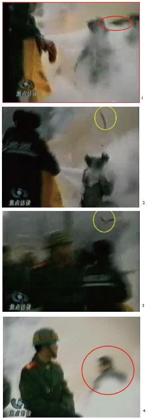 """中央电视台《焦点访谈》播出的自焚伪案节目慢动作分析,1.在灭火器喷射的同时,一只手臂抡了起来,猛击刘春玲的头部。2. 重物猛击刘的头部后被弹起。3. 重物逆着灭火器喷射流飞向员警。4. 一名身穿大衣的男子正好站在出手打击的方位,仍然保持着一秒钟前用力打击的姿势。这出前政法委书记罗干紧跟江泽民炮制出来诬陷法轮功的自焚伪案,最近有目击者揭露与法轮功毫无关系的""""自焚者""""刘春玲是被用灭火器猛击头部致死。(明慧网)"""