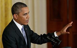 """美国总统奥巴马(如图)于2013年8月9日的记者会上,嘲讽俄罗斯总统普京重演冷战时期戏码,并呼吁普京应""""向前看而不该向后望""""。(Win McNamee/Getty Images)"""