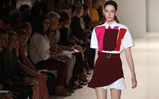 """2013年9月8日,纽约时装周设计师""""贝嫂""""维多利亚贝克汉为2014年春夏打造较为男性化、率性的全新系列。(Mehdi Taamallah/AFP)"""