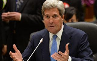 美國國務卿克里於2013年10月9日抵達汶萊,出席東南亞國家聯盟(ASEAN)與美國的峰會。克里此行的首要任務,是推動東南亞領袖與中共,針對南中國海領土的爭議進行協商,並加強華府與東盟各國的關係。(攝影:PHILIPPE LOPEZ/AFP/Getty Images)