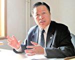 二零零五年十一月高智晟律师在去办公室接受采访。(AFP)