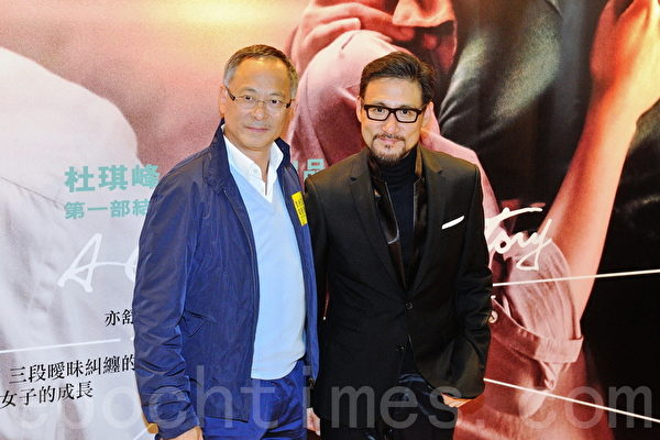 张学友(右一)与香港著名电影导演杜琪峰。(宋祥龙/大纪元)