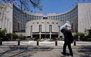 大陸銀行危機一旦爆發,高達107萬億的廣義貨幣將引起金融海嘯。(AFP PHOTO/Mark RALSTON)