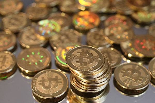 比特币10月12日每枚升破5,200美元。(George Frey/Getty Images)