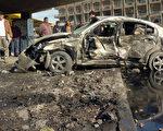 伊拉克15日发生多起汽车炸弹爆炸,已造成至少有75人丧生和128人受伤。(ALI AL-SAADI/AFP)